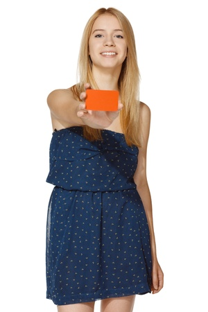 Young joyful female giving you a blank credit card, over white background photo