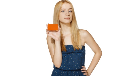 Young female holding blank credit card, over white background photo