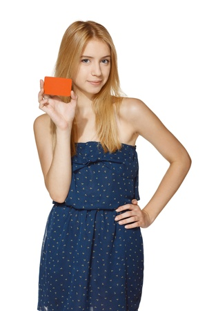 Young smiling female holding blank credit card, over white background photo
