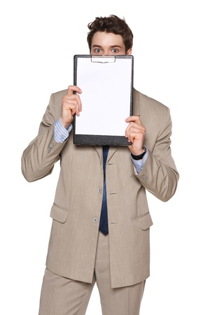 Business man holding blank papper clipboard in front of his face, against white background photo