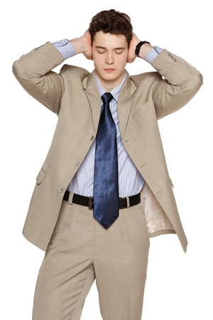 endure: Annoyed businessman covering his ears with his hands Stock Photo