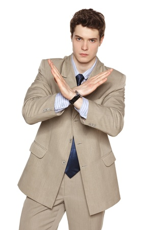 Young business man making stop gesture against white background Stock Photo - 20206419