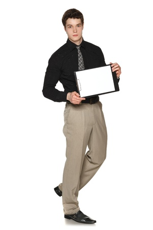 serious businessman: Young serious businessman showing blank clipboard, over white background