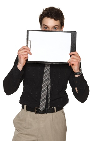 Business man holding blank paper clipboard in front of his face, against white background photo