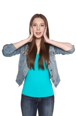 Surprised casual female holding head in hands, against white background Stock Photo - 20498696