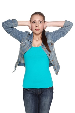 inconvenience: Woman covering with hands her ears, isolated over white background Stock Photo