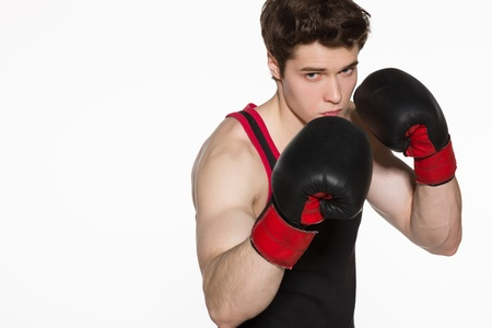health care fight: Closeup of young boxer fighter over white background