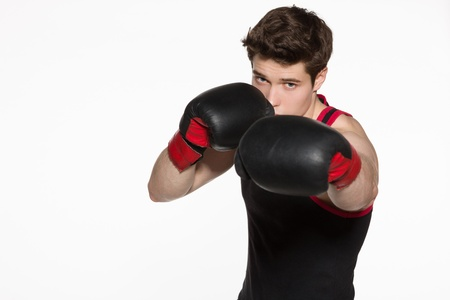 Closeup of young boxer fighter over white background photo