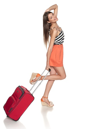 Happy woman running with suitcase, over white background