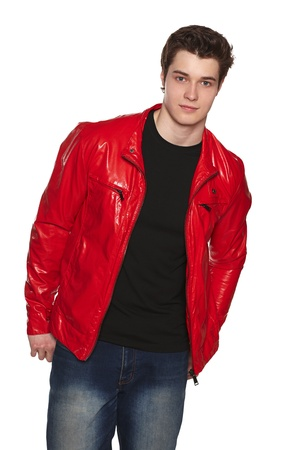 Young man wearing bright red jacket, over white background photo