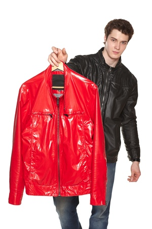 Young male showing red bright leather jacket, shallow depth of field, focus on the jacket. Against white background photo