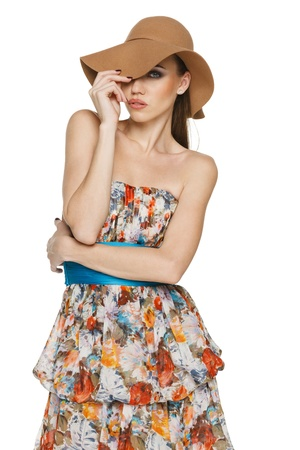 sundress: Fashion woman wearing light chiffon dress and a hat against white background
