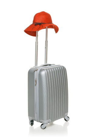 straw hat: Silver suitcase with red straw hat on the handle isolated on white background Stock Photo