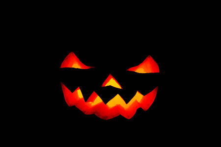 Jack O Lantern halloween terrifying smile against black background Stock Photo - 23032959