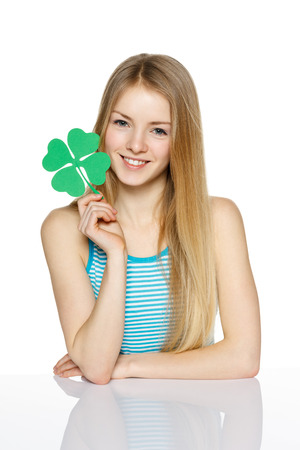 Young female holding leaf symbol, over white background photo