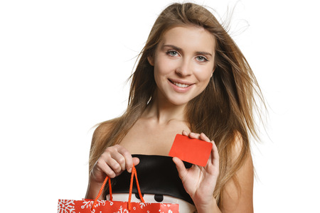 woman holding bag: Shopping woman holding bag and blank credit card, isolated on white background.