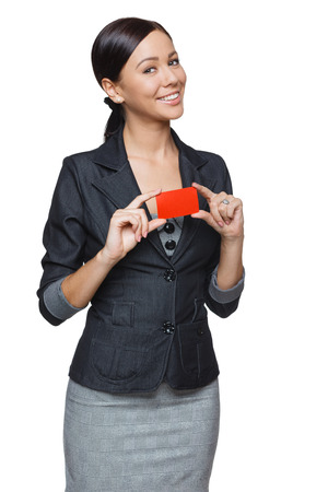 creditcard: Smiling business woman holding credit card isolated on white background