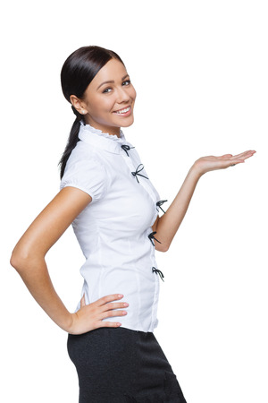 Business woman showing  holding on the palm blank copy space over white background