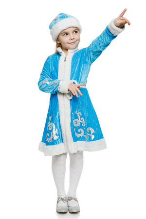 snow maiden: Little girl wearing blue suit of snow maiden standing in full length pointing to the side, over white background