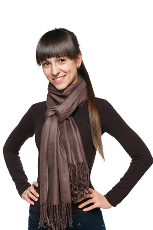 Smiling candid brunette female in pullover and scarf photo