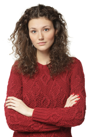 Young beautiful female in sweater with folded hands, isolated on white background photo