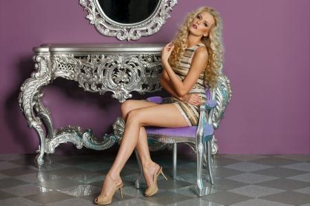 Portrait of fashion model posing in glamorous interior photo