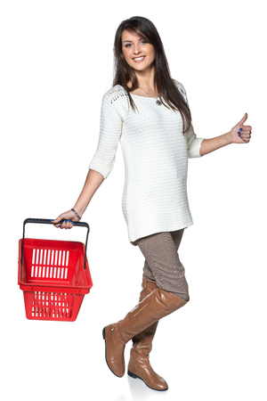 full length woman: Full length woman walking with red shopping basket, white