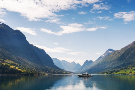 scandinavian landscape: Yacht on Nordfjord, Olden city, Norway
