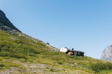 Summer houses in mountains, in Jotunheimen national park, Norway photo