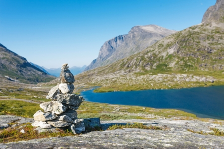 jotunheimen national park: Stack of rocks with mountain and lake view, Jotunheimen national park, Norway Stock Photo