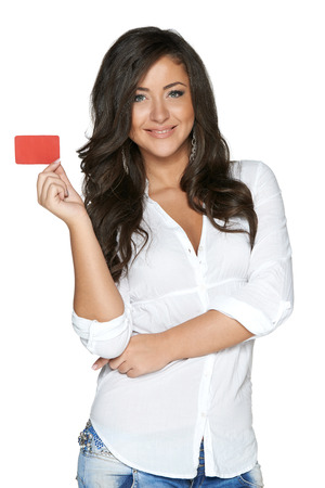 Beautiful smiling girl showing red card in hand, over white