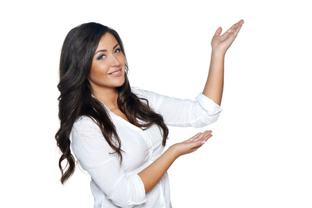 Beautiful  woman showing / holding on the palm blank copy space over white