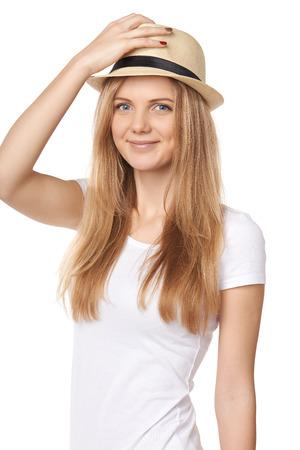 uplifting: Candid joven casual saludo elevar su sombrero de paja Foto de archivo