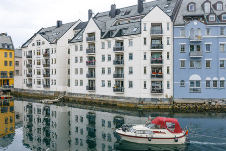 alesund: Downtown Alesund, Norway  Art Nouveau architecture  Boat in the harbor Stock Photo