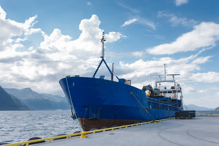 embark: Cargo boat in dock, Norway Stock Photo