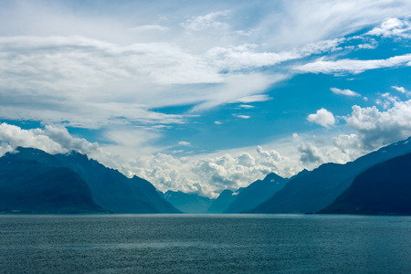 Norway  Fjord scene with hazy mountains and cloudy sky in a overcast day photo