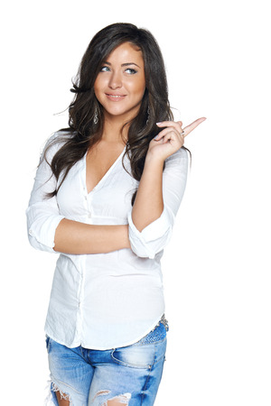 Woman smiling pointing up showing copy space, isolated on white background  Banque d'images