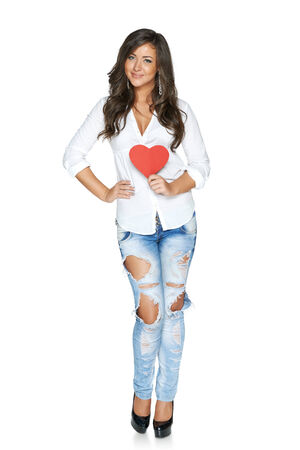 full length woman: Full length woman in funky ragged jeans and white shirt showing heart isolated on white background Stock Photo