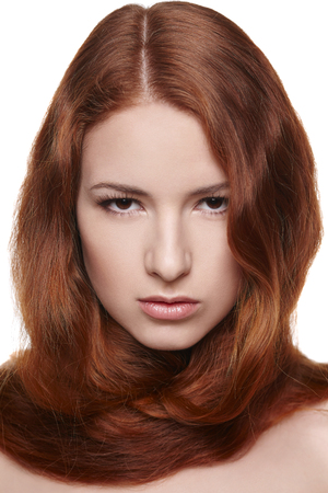 Closeup of beautiful red headed woman over white background