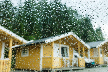 Camping cabins in heavy rain - view through the window photo