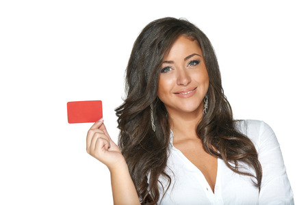 Beautiful smiling girl showing red card in hand, over white background photo