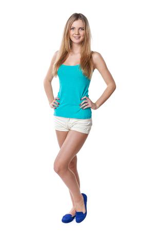 Lovely teen girl in full length standing casually, against white background Stock Photo