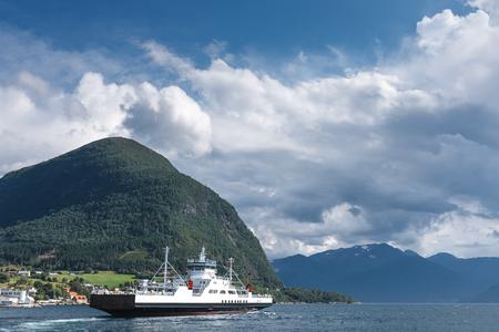 ferryboat: Ferryboat cruising on Norwegian fjord Stock Photo