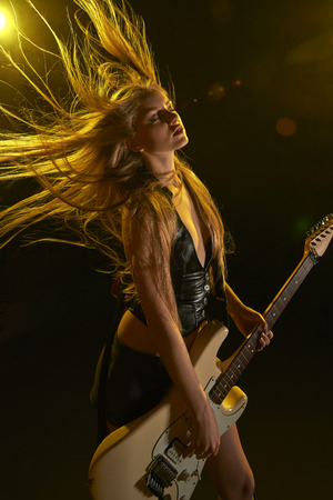woman guitar: Young attractive rock girl playing the electric guitar Stock Photo