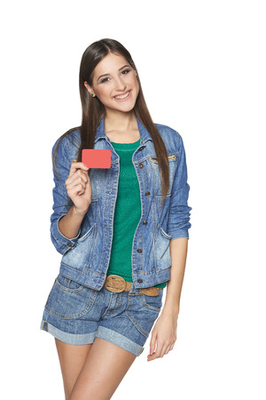 Smiling young female showing a blank card, isolated on white background photo