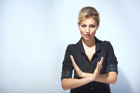 Serious businesswoman making halt sign