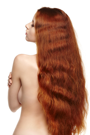 Beautiful long red hair woman photo