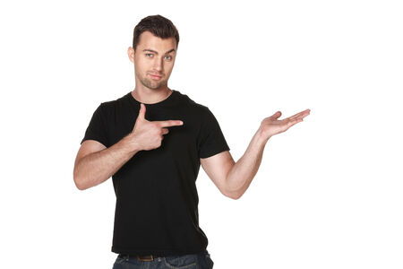 Man holding blank copy space on the palm and pointing at it, over white background