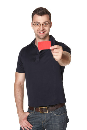 outstretching: Smiling male in eyeglasses giving you red empty card, over white background