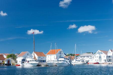 Skudeneshavn village in Norway, white wooden houses photo